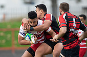 Walter Fifita gets tackled by George Crichton. Counties Manukau Premier Club Rugby game between Papakura and Karaka played at Massey Park Papakura on Saturday May 5th 2018. Papakuar won the game 28 - 25 after trailing 6 - 12 at halftime.<br /> Papakura - Faalae Peni, Darryl Hemopo, George Crichton, Federick Cain tries, Faalae Peni conversion; Faalae Peni 2 penalties, Karaka -Salesitangi Savelio, Cardiff Vaega, Walter Fifita tries, Juan Benadie 2 conversions, Juan Benadie 2 penalties.<br /> Photo by Richard Spranger.