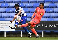 7th July 2020; Madejski Stadium, Reading, Berkshire, England; English Championship Football, Reading versus Huddersfield; Gabriel Osho of Reading crosses under pressure from Karlan Grant of Huddersfield