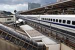 A shinkansen bullet train passes through/stops at Shin-Yokohama Station in Yokohama, Japan. Photographer: Robert Gilhooly