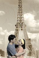 Romantic Asian couple at Eiffel Tower. Paris, France