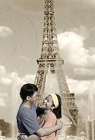 Romantic Asian couple at Eiffel Tower. Paris, France