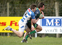 Saturday 27th April 2013 - Paul Pritchard is tackled by Stuart McCloskey during the final Ulster Bank League clash against Dungannon at Stevenson Park. Photo Credit : John Dickson / DICKSONDIGITAL