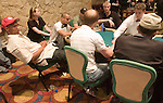 Phil Ivey leans back in his chair during action.