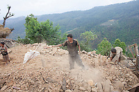 A Man taking out the rubble from his destroyed house at Jalkeni village, Karvrepalanchowk, outside of Kathmandu, Nepal . May 1, 2015