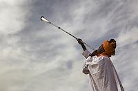 Court musician play kakaki horn outside of Zazzau Emir's Palace, Zaria, Nigeria.