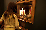 A girl looks at a miniature room exhibit at the Art Institute of Chicago, Chicago, IL