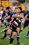 Callum Bruce has to go high in order to try and stop Niva Ta'auso during the Air NZ Cup game between Counties Manukau & Otago played at Mt Smart Stadium,Auckland on the 29th of July 2006. Otago won 23 - 19.