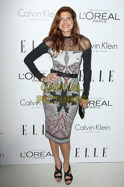 Lake Bell.ELLE's 19th Annual Women In Hollywood Celebration held at Four Seasons Hotel, Beverly Hills, California, USA..October 15th, 2012.full length sheer off the shoulder black white sleeves print pattern red clutch bag hand on hip.CAP/ADM.©AdMedia/Capital Pictures.