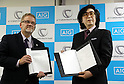 November 21, 2016, Tokyo, Japan - Japan's Tsukuba University professor and high-tech venture Cyberdyne president Yoshiyuki Sankai (R) and insurance company AIG Japan Holdings president Robert Noddin (L) display their exchanged documents on their agreement for business collaboration at a press conference at AIG Japan headquarters in Tokyo on Monday, November 21, 2016. AIG Japan will develop insurance products and related services using Cyberdyne's robot suit Hybrid Assistive Limb (HAL) and other technologies such as vital sensors.   (Photo by Yoshio Tsunoda/AFLO) LWX -ytd-