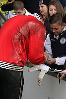 Chris Dilo signs autographs in the St Mirren v Ross County Scottish Professional Football League Premiership match played at St Mirren Park, Paisley on 3.5.14.