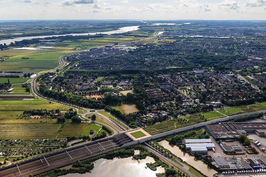 Nederland, Zuid-Holland, Barendrecht, 15-07-2012; zuidelijk deel van de Overkapping Barendrecht. Op het dak van de Overkapping is o.a. een vlinderpark aangelegd, de constructie is gebouwd over 9 spoorlijnen, waaronder HSL en Betuweroute, om geluidsoverlast tegen te gaan. In de achtergrond de Oude Maas..The railway station is part of the covering-over of the HST in Barendrecht (SW Netherlands) . Roof landscape has a parking lot and a butterfly garden. The river Old Meuse (Maas) in the background. .luchtfoto (toeslag), aerial photo (additional fee required).foto/photo Siebe Swart