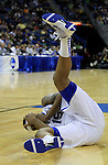 Freshman forward DeMarcus Cousins falls to the ground after being elbowed during the first half of the UK men's basketball against Wake Forest for the second round of the NCAA tournament at New Orleans Arena on Saturday, March 20, 2010. The Cats were up on the Deacs 44-28 at the half. Photo by Adam Wolffbrandt | Staff