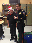 Harris County Sheriff Adrian Garcia reads t students at Cook ES.