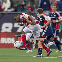 Portland Timbers forward/midfielder Darlington Nagbe (6) attempts to control the ball as New England Revolution midfielder Kelyn Rowe (11) pressures. In a Major League Soccer (MLS) match, the New England Revolution defeated Portland Timbers, 1-0, at Gillette Stadium on March 24, 2012
