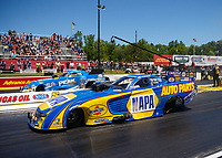 May 7, 2017; Commerce, GA, USA; NHRA funny car driver Ron Capps (near) races alongside John Force during the Southern Nationals at Atlanta Dragway. Mandatory Credit: Mark J. Rebilas-USA TODAY Sports