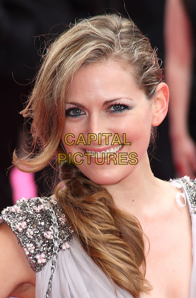 OLIVIA LEE .UK Premiere of 'Killers' at the Odeon West End, Leicester Square, London, London, England, UK, June 9th 2010.portrait headshot smiling side ponytail beaded jewel encrusted gem embellished mouth open .CAP/JIL.©Jill Mayhew/Capital Pictures