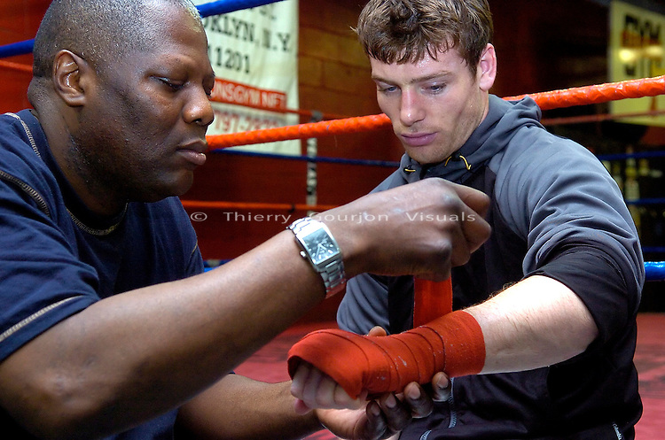 John Duddy (r) with trainer Harry Keitts  preparing for a  training session  at Gleason's Gym in Brooklyn, NY on 05.31.06. Duddy is preparing for his upcoming WBC Continental Americas Middleweight Championship fight against Freddy Cuevas at MSG on June 10th, 2006.