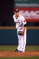 Rochester Red Wings relief pitcher Marcus Walden (18) looks in for the sign during a game against the Columbus Clippers on June 14, 2016 at Frontier Field in Rochester, New York.  Rochester defeated Columbus 1-0.  (Mike Janes/Four Seam Images)