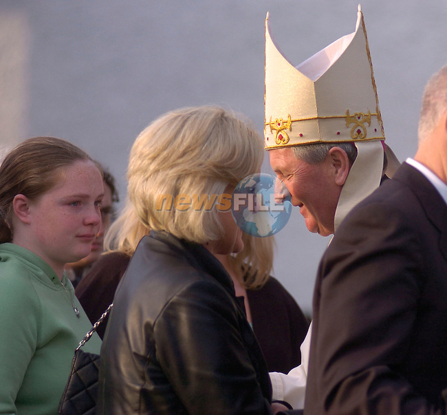 230506 - Meath Bishop Michael Smith greets relative o of the girls that died in teh school crash at Kentstown last year..Photo:Barry Cronin/Newsfile.