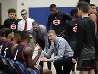 NWA Democrat-Gazette/ANDY SHUPE<br /> Springdale coach Jeremy Price speaks to his team against Har-Ber Friday, Feb. 8, 2019, during the first half of play in Wildcat Arena in Springdale. Visit nwadg.com/photos to see more photographs from the games.