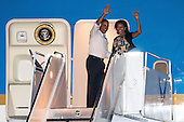 United States President Barack Obama and first lady Michelle Obama wave to well-wishers as they board Air Force One for their return trip to Washington at Joint Base Pearl Harbor-Hickam on Saturday January 5, 2013 in Honolulu, Hawaii..Credit: Kent Nishimura / Pool via CNP