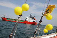 "- campaign ""Green Schooner"" for pollution monitoring in Italian seas waters, organized by enviromentalist association ""Legambiente""; on board of schooner ""Catholica"" (year of construction 1936), gas tanker ship approac the port of Ravenna....- campagna ""Goletta Verde"" per monitorare l'inquinamento delle acque nei mari organizzata dall'associazione ambientalista italiana ""Legambiente""; a bordo della goletta ""Catholica"" (anno di costruzione 1936), nave gasiera al largo del porto di Ravenna.."