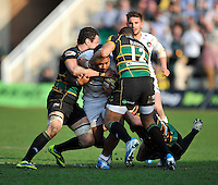 Northampton, England.  Manusamoa Tuilagi of Leicester Tigers tackled during the Northampton Saints and Leicester Tigers  during the Aviva Premiership match at Franklin's Gardens, Northampton, England on March 29, 2014