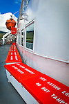 Deck of Kennicott Ferry, Alaska Marine Highway System.  Life saving equipment containers in the foreground. A life boat is in the background.