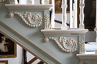 A detail of the carved decoration on the side of the staircase