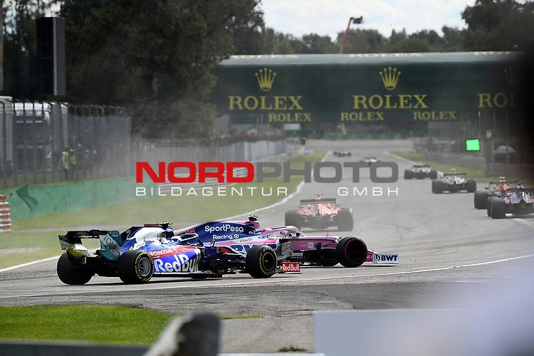 """08.09.2019, Autodromo Nazionale di Monza, Monza, FORMULA 1 GRAN PREMIO HEINEKEN D'ITALIA 2019<br />,im Bild<br />Sebastian Vettel (GER#5), Scuderia Ferrari Mission Winnow verliert seinen Ferrari in der """"Variante Ascari"""", Lance Stroll (CAN#18), Sportpesa Racing Point F1 Team kann nicht ausweichen und dreht sich und behindert Pierre Gasly (FRA#10), Red Bull Toro Rosso Honda<br /> <br /> Foto © nordphoto / Bratic"""