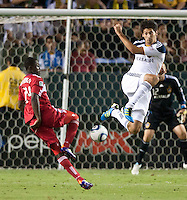 CARSON, CA – July 9, 2011: LA Galaxy defender Omar Gonzalez (4) during the match between LA Galaxy and Chicago Fire at the Home Depot Center in Carson, California. Final score LA Galaxy 2, Chicago Fire FC 1.