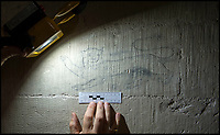BNPS.co.uk (01202 558833)<br /> Pic: PhilYeomans/BNPS<br /> <br /> A 'Royal' lion or leopard.<br /> <br /> Salisbury Cathedral has taken the unusual step of launching 'Grafitti Tours' of it's 800 year old building, as part of a three year project to document the thousands of examples of centuries-old 'graffiti' which adorn the walls of the 13th century cathedral.<br /> <br /> The inside of the Cathedral in Wiltshire is covered in markings etched into its fabric by fervent, desperate or just bored visitors ranging from simple inscriptions to more intricate designs used to ward off evil spirits.  <br /> <br /> Cathedral guide Steve Dunn intends to record all the marks or 'graffiti' which in some cases date back from when the cathedral was completed in 1258.<br /> <br /> Helped by about 60 volunteers, he is collating images of the graffiti and researching the story behind them.