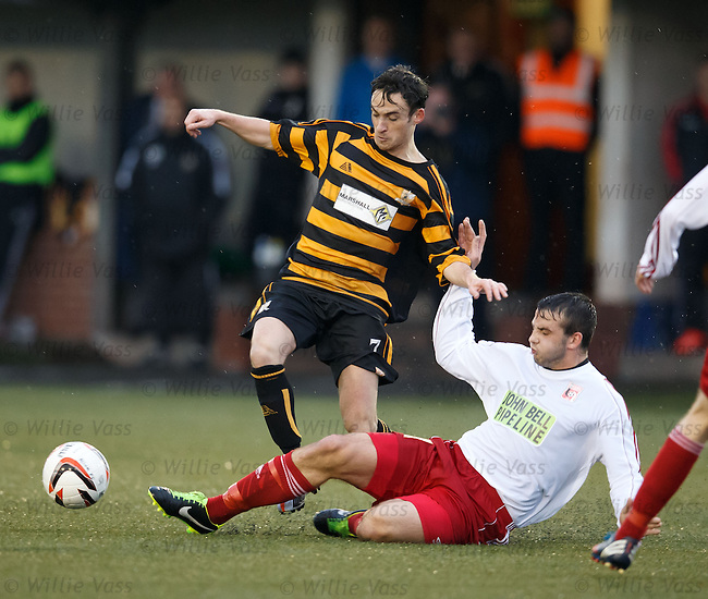 Kevin Cawley of Alloa tackled by Inverurie's Kieran Adams