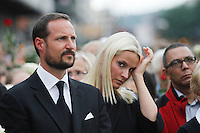 (Oslo July 25, 2011) Crown Prince Haakon  and HRH Mette-Marit listen to a speach. An estimated 150,000 people gathered in Oslo town centre for a vigil following Friday's twin extremist attacks ...A large vehicle bomb was detonated near the offices of Norwegian Prime Minister Jens Stoltenberg on 22 July 2011. .Another terrorist attack took place shortly afterwards, where a man killed 68 people, mainly children and youths attending a political camp at Utøya island. ..Anders Behring Breivik was arrested on the island and has admitted to carrying out both attacks..(photo:Fredrik Naumann/Felix Features)