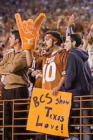 04 November 2006: Malek Abijaoude (center) cheers the Texas Longhorns as he holds a sign during the Longhorns 36-10 victory over the Oklahoma State University Cowboys at Darrel K Royal Memorial Stadium in Austin, Texas.