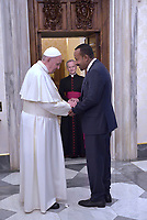 Pope Francis exchanges gifts with Ethiopian Prime Minister Abiy Ahmed during a private audience at the Vatican on January 21, 2019.