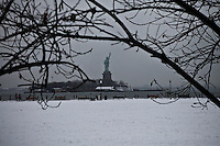 The Statue of Liberty is seen from Jersey City during the season's first snow storm on December 10, 2013 in New York City Photo by Kena Betancur / VIEWpress.