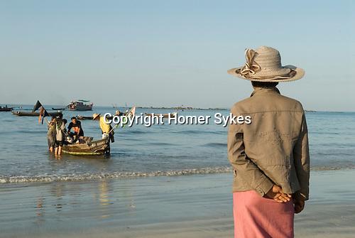 Ngwe Saung beach resort, fisherman bring their  nights catch in.  Burma Myanmar 2011