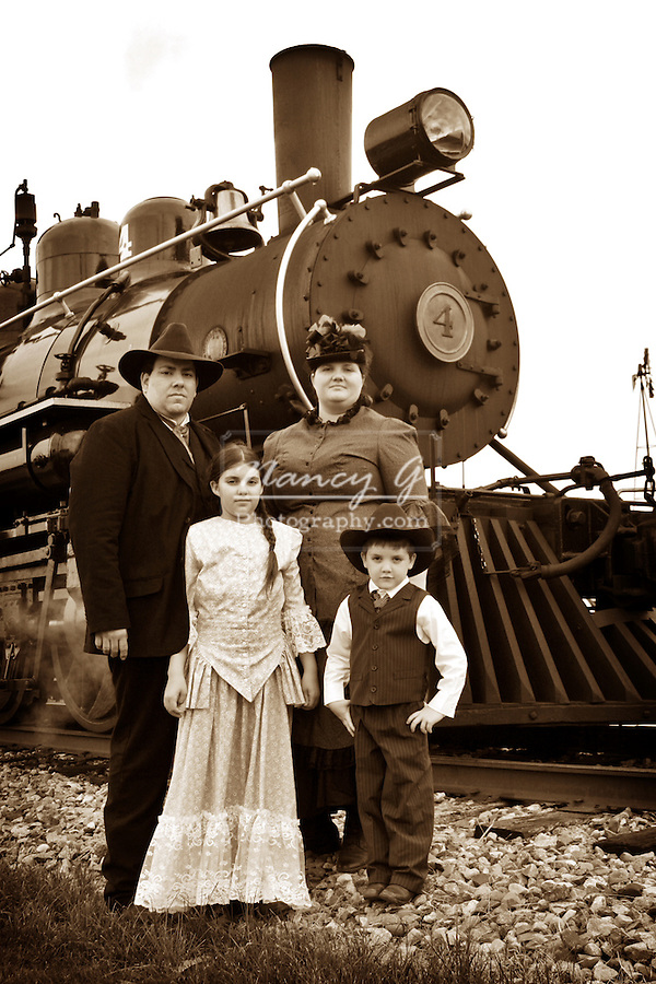 Family in front of a Steam Engine No. 4 Train