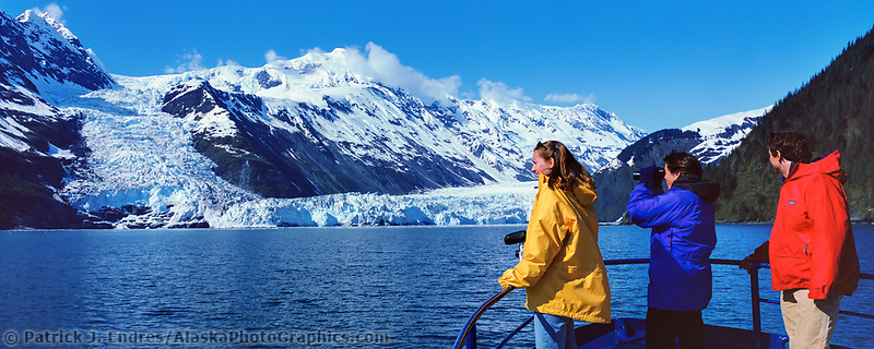 Tourists on the bow of the MV Discovery enjoy views of Barry and Cascade glacier in Barry Arm, Prince William Sound