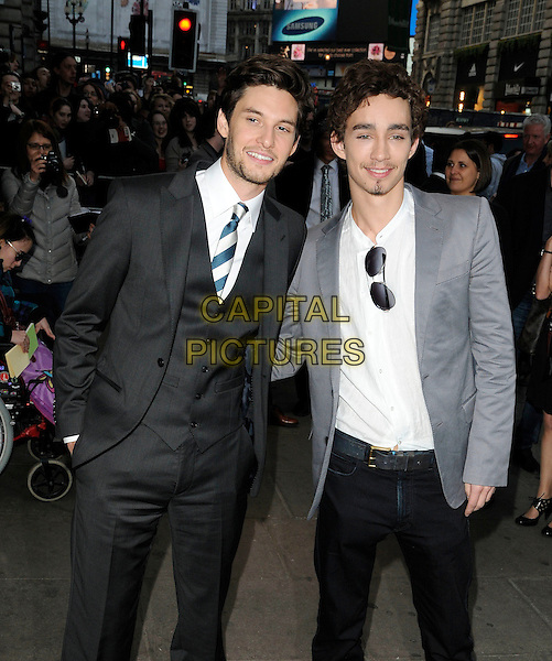 "BEN BARNES & ROBERT SHEEHAN .At the ""Killing Bono"" World Film Premiere, Apollo cinema, West End, Regent Street, London, England, UK, March 28th 2011..half length black suit white shirt tie grey gray waistcoat hand in pocket beard facial hair  .CAP/CAN.©Can Nguyen/Capital Pictures."