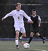 Charles Gugel #2 of Massapequa moves the ball upfield during the Nassau County Class AA varsity boys soccer playoffs against Syosset at Adelphi University on Sunday, Oct. 30, 2016. Thunder, lightning and heavy rain necessitated a delay nine minutes into the second half a scoreless match.