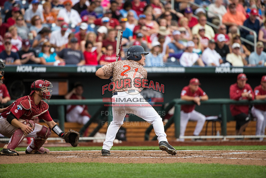 Matt Thaiss (21) of the Virginia Cavaliers bats during a game between the Virginia Cavaliers and Arkansas Razorbacks at TD Ameritrade Park on June 13, 2015 in Omaha, Nebraska. (Brace Hemmelgarn/Four Seam Images)