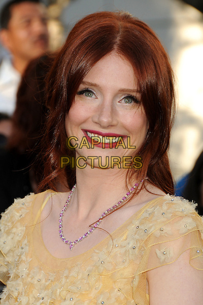 "BRYCE DALLAS HOWARD .""The Twilight Saga: Eclipse"" Los Angeles Premiere at the 2010 Los Angeles Film Festival held at Nokia Theatre LA Live, Los Angeles, California, USA, 24th June 2010..portrait headshot red lipstick make-up necklace pink flowers  yellow ruffles ruffle smiling .CAP/ADM/BP.©Byron Purvis/AdMedia/Capital Pictures."