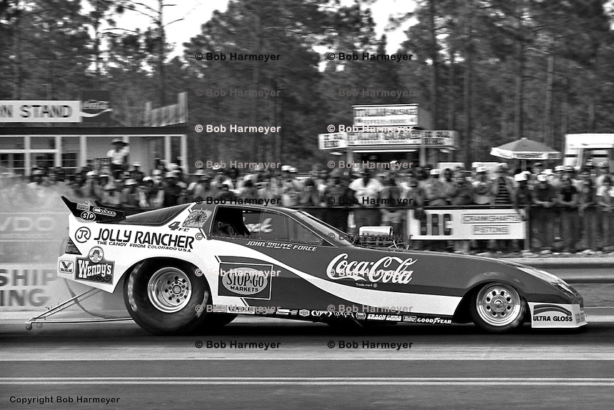 GAINESVILLE, FL - MARCH 18: John Force drives his Funny Car during the NHRA event on March 18, 1984, at Gainesville Raceway near Gainesville, Florida.