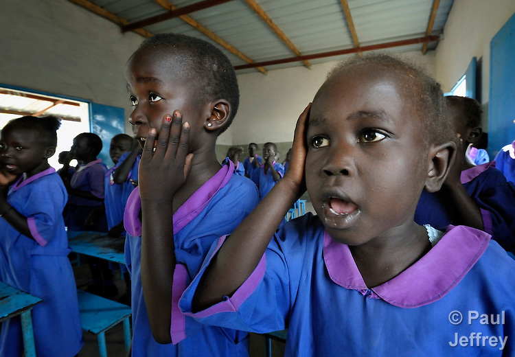 Students sing a song with hand motions in a Catholic school in Malakal, Southern Sudan. NOTE: In July 2011 Southern Sudan became the independent country of South Sudan.