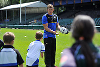 Stuart Hooper of Bath Rugby runs the passing clinic. Bath Rugby Family Festival of Rugby, on August 8, 2015 at the Recreation Ground in Bath, England. Photo by: Patrick Khachfe / Onside Images