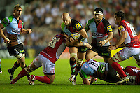 George Robson of Harlequins is tackled by Paulica Ion of London Welsh during the Aviva Premiership match between Harlequins and London Welsh at the Twickenham Stoop on Friday 7th September 2012 (Photo by Rob Munro)