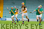 Michael O'Leary, Abbeydorney in action against Paudie O'Connor and Jordan Brick, Kilmoyley, in the Senior Kerry Hurling Championship at Austin Stack Park on Sunday.