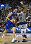 South Dakota State forward Mike Daum (24) drive the lane against Nevada's Trey Porter (15) in the second half of an NCAA college basketball game in Reno, Nev., Saturday, Dec. 15, 2018. (AP Photo/Tom R. Smedes)
